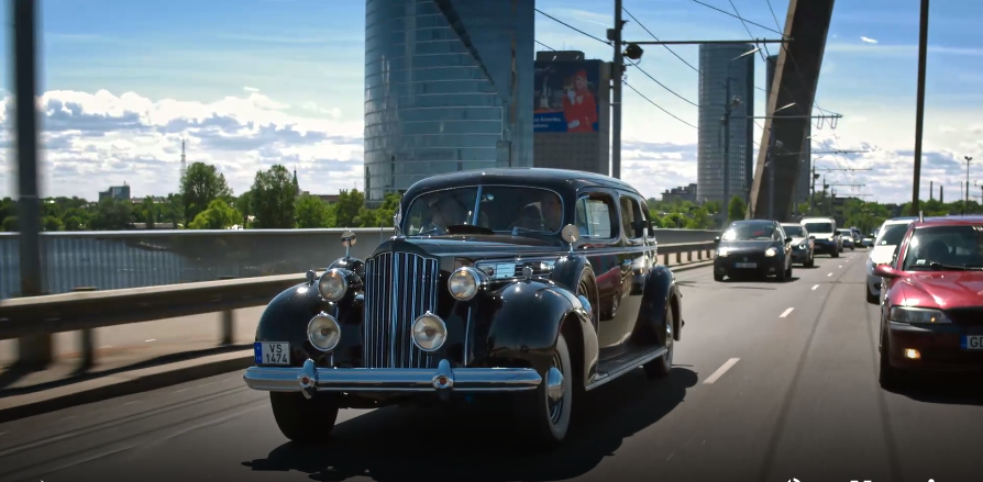 Classic car on streets of Riga, Latvia; promotional film for Riga Motor Museum