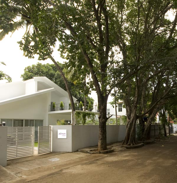 white house surrounded by trees, sangam house in India