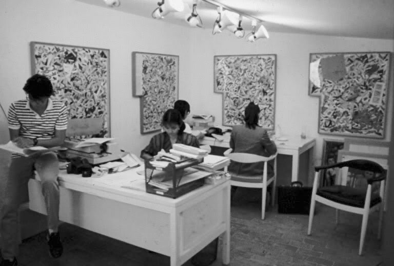 Nilo Ilarde and the staff of Pinaglabanan Galleries in their office, October 1984. On the walls are several of Roberto Chabet's China Collages