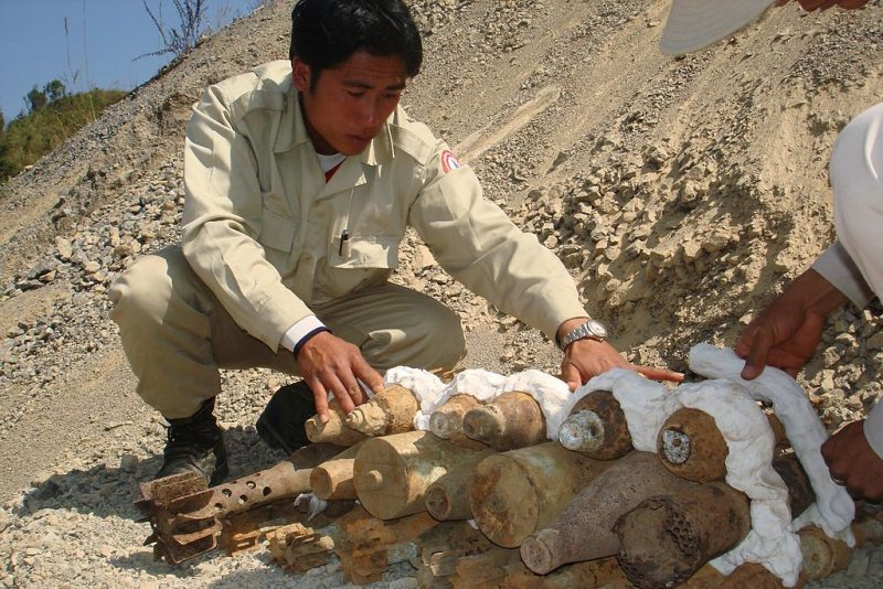 UXO_Lao_SEOD_technition_preparing_UXO_for_destruction,_2007._Photo-_Steffen_Peter_UXO_Lao_(10684436376)