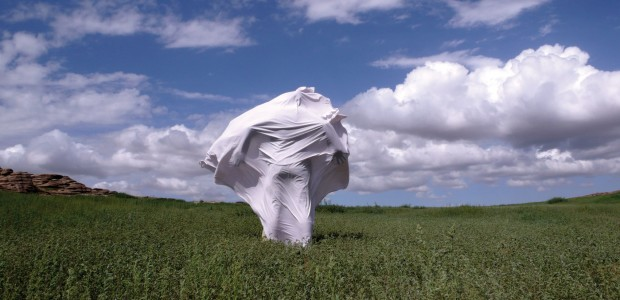 "Megumi Shimizu, ""The wind is strong"" performance, white sheet, image courtesy of the Modern Mongolian National Art Gallery"