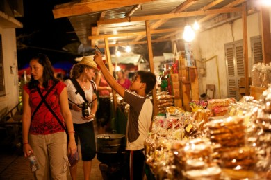 Shooting practice. Night market, Luang Prabang, Laos.